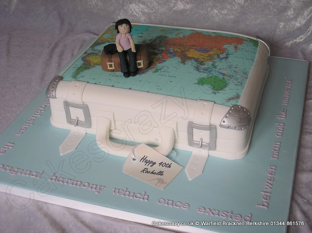 Suitcase Cake. Suitcase shaped novelty cake with the atlas of the world and a modelled traveller. Finished with a personal Australian themed edible travel tag