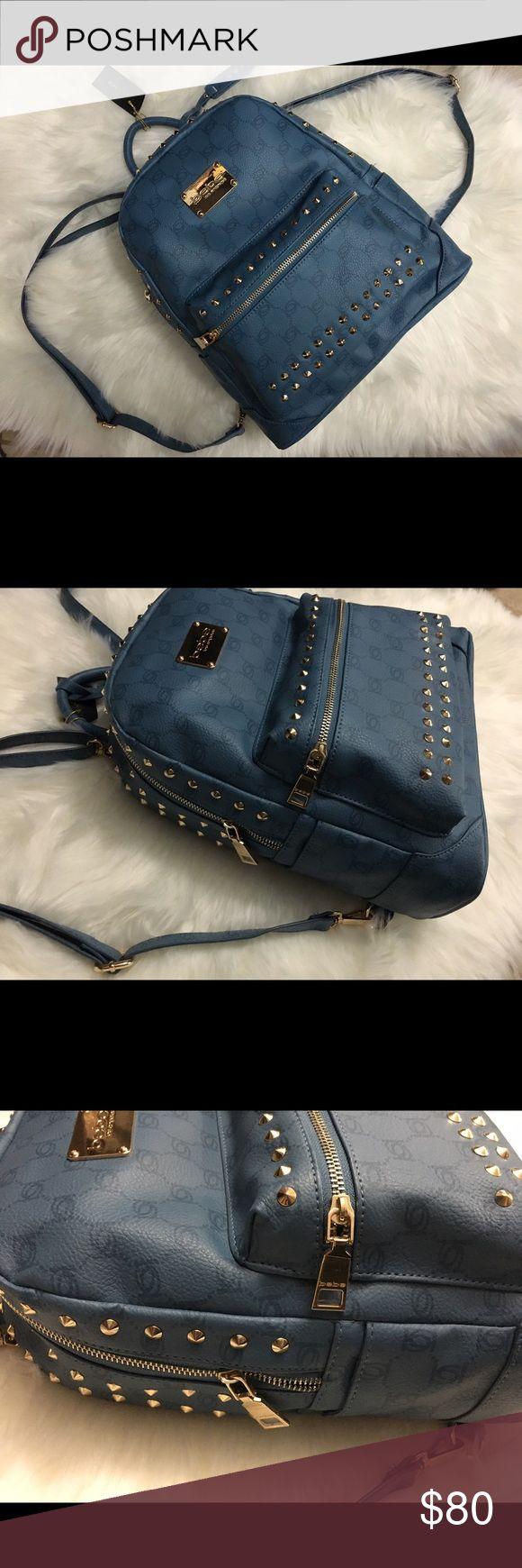 Bebe denim leather blue gold studded backpack Large bebe backpack blue denim like pattern monogrammed vegan leather handbag with gold studded design bebe Bags Backpacks