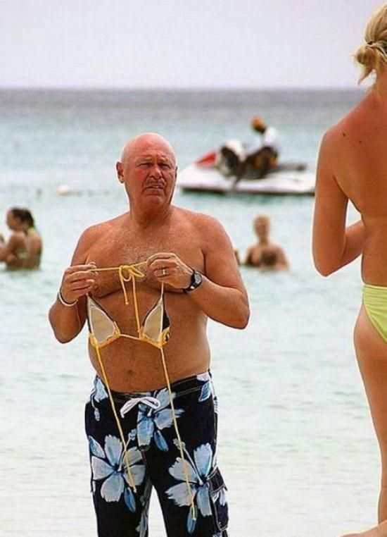 Martha, This Doesnt Fit In This Picture: Photo of man with bra on beach