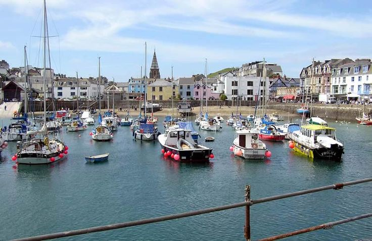 Ilfracombe, North Devon - Harbour , along the quay are nic nack shops , ice cream shops, pubs, and the small sea life centre which used to be the old life boat station . Not much has changed over the years
