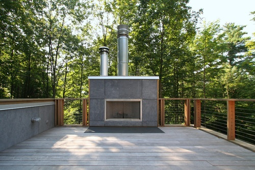 Outdoor fireplace panels are cement board in eter gray by