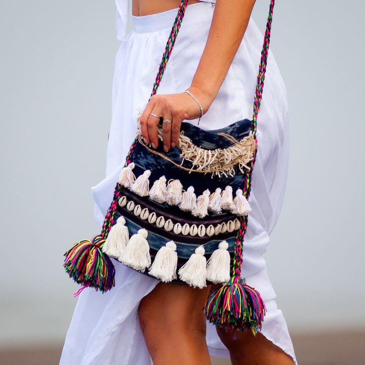 Marrakech Bilum Bag, BOHO Tassel Bag, Handmade Unique Shaggy Hip Bag, Bilum Bag with Shells, Hessian, Tassels, Ikat Fabric by ljcdesignss on Etsy https://www.etsy.com/listing/242355598/marrakech-bilum-bag-boho-tassel-bag