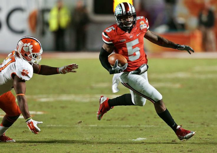 Ohio State quarterback Braxton Miller (5) runs past Clemson Tigers safety Robert Smith