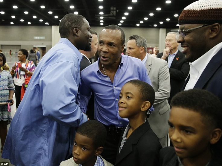 Former boxing champion Sugar Ray Leonard, center, is greeted by former two time heavyweight world champion Hasim Rahman before Muhammad Ali's Jenazah on Thursday