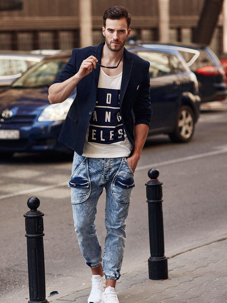 Perfect casual styling from Bolf is boosted up by a slim fit blazer. The white cotton printed tank top works well with denim joggers. This streetwear duet is softened by a navy blue blazer and universal dark sunglasses.
