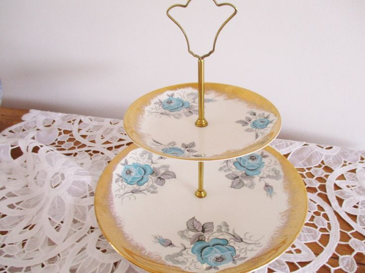 VINTAGE 2 TIER CAKE stand by Royal Falcon Ware, England, blue roses with heavy gilt border, gold tone metal handle, excellent condition