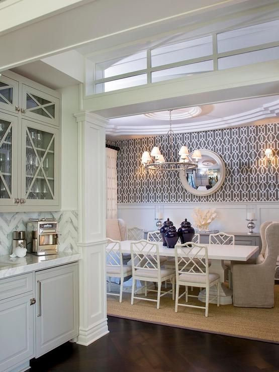Gray butler's pantry features glass-front upper cabinets and gray lower cabinets paired with grey ... #eathappy