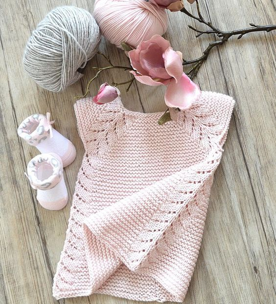 This seamless little top down dress / tunic top is an easy knit, worked in garter stitch with a simple leaf pattern forming the front borders, then cascading down the sides. Find this beautiful baby pink dress pattern at LoveKnitting.Com.