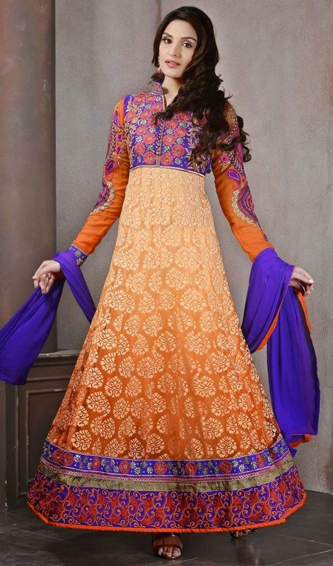Look amazing with this apricot, blue and orange brasso long Anarkali suit. This attire is effectively made with lace, patch, resham and stones work. #StylishEveningSuit