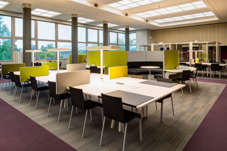 University of Reading - Library: Vitra Joyn desking with Vitra .03 chairs.  SpaceOasis sage and Boss design Vista pod