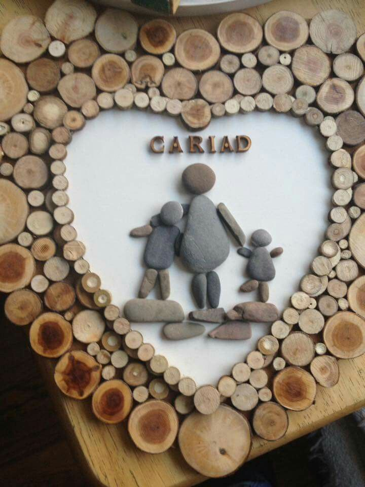 Pebble Welsh family heart framed with wood slices