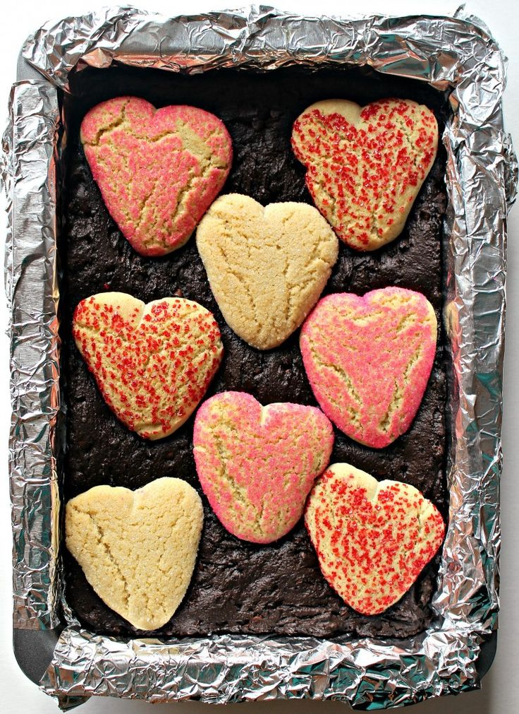 Sugar Cookie Valentine Brownies- Everyone LOVES these brownies! So fudgy! So sparkly! So easy! Use a store bought roll of sugar cookie dough with these amazing brownies to delight your Valentine! @ themondaybox.com #valentinestreats #romanticdesserts #valentinesdaydessert #valentinesweets