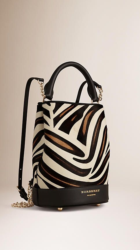 Burberry Bucket Backpack in animal-print calfskin with chain and leather straps. A runway icon designed in London and crafted in Italy. Hand-finished details capture the collection's bohemian attitude. Discover the women's bags collection at Burberry.com