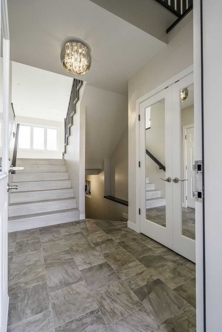 Gorgeous lighting & mirrored closet doors in this entrance way.