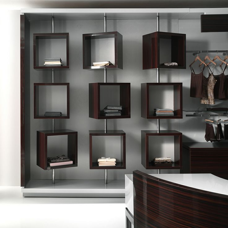 """The """"C-shaped"""" system, which features a single finishing backdrop with lateral sections, makes it possible to conceal the shelving support slots. The look is light and minimalist, thanks to the intelligent deployment of floor wells and reveals. In the curved version, the """"MW"""" counter is integrated into the overall design, with co-ordinated finishes.  #revolution #shopfitting #crc #italian #design #madeinitaly #arredamento #negozi"""