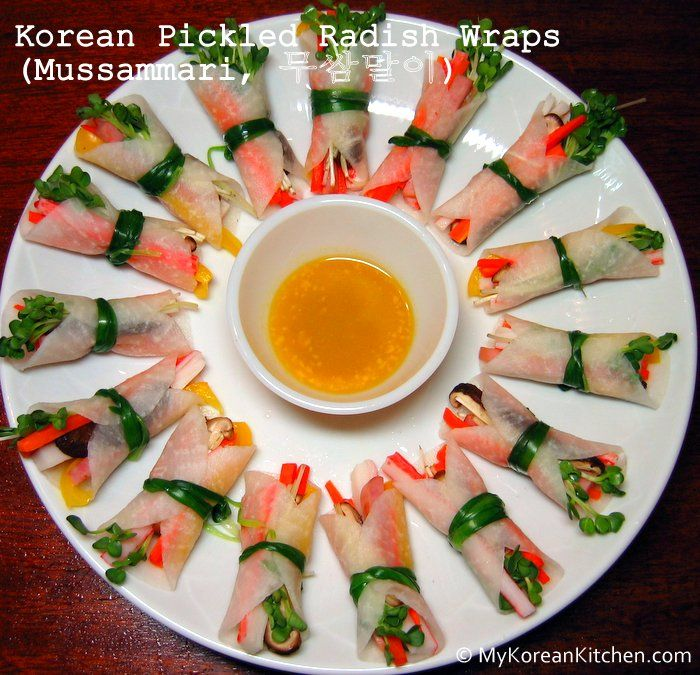 KOREAN PICKLED RADISH WRAPS (MUSSAMMARI) #korean - Ingredients (For 3 servings)  Thin sliced radish pickle 1 pack (Ssam-Mu, 쌈무)Ingredients for radish wraps 1/3 a capsicum (I used yellow one) 1/4 a medium size carrot 2 crab sticks 1/5 block of ham from 160g Radish sprouts 2 shiitake mushrooms Garlic chives or drop wort for string For dipping sauce (Mix them together in a bowl.)  Mustard 1/2 tsp Vinegar 1/2 tsp Sugar 1/2 tsp Water 1/2 tsp  ====