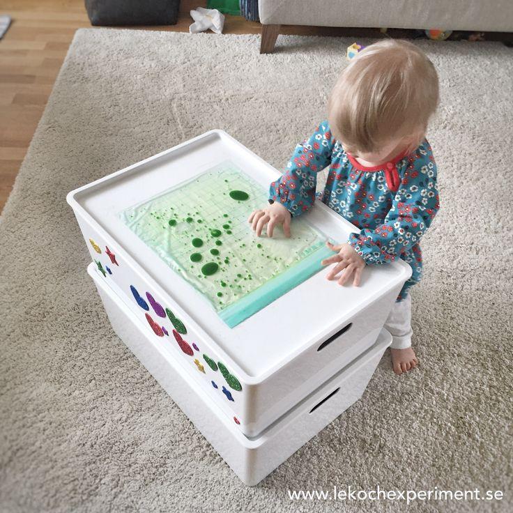 Upptäckarpåse me vatten och olja sensorisk lek för barn
