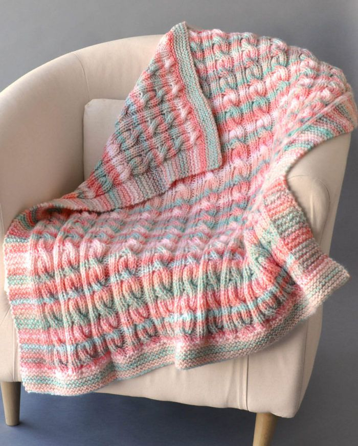 Free Knitting Pattern for Reversible Cable Blanket - Reversible blanket looks the same on both sides. 2 sizes: Baby Blanket and Throw Blanket. Designed by Rachel Brockman for Universal Yarn. Bulky yarn.