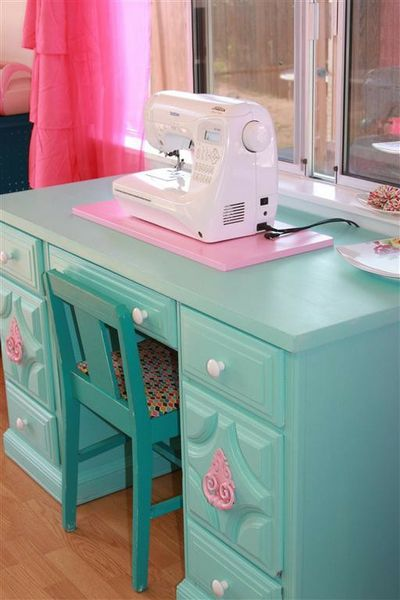 Updated Scrapbook Room - Two Peas in a Bucket turquoise sewing desk with bits of pink.