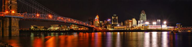 Cincinnati, Ohio | Three shot panorama taken from the Kentucky side of the Ohio River, looking into Ohio.  The National League Central Champion Cincinnati Reds were beating up on the Houston Astros, winning 9-1 at Great American Ball Park.  Paul Brown Stadium, home of the Cincinnati Bengals, can be seen under the bridge off to the left.  I had to cut off the bridge to the right due to a docked boat.  Cincinnati, Ohio 9-30-10
