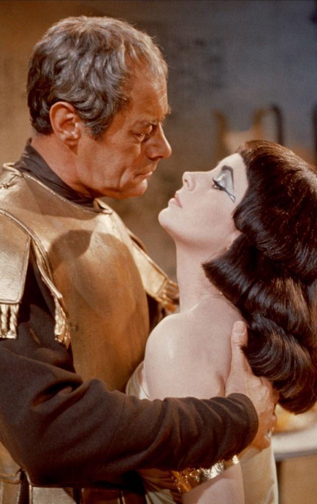 CLEOPATRA (1963) - Julius Caesar (Rex Harrison) embraces the exotic Cleopatra (Elizabeth Taylor) - Produced & Directed by Joseph L. Manciwietz - 20th Century-Fox - Publicity Still.