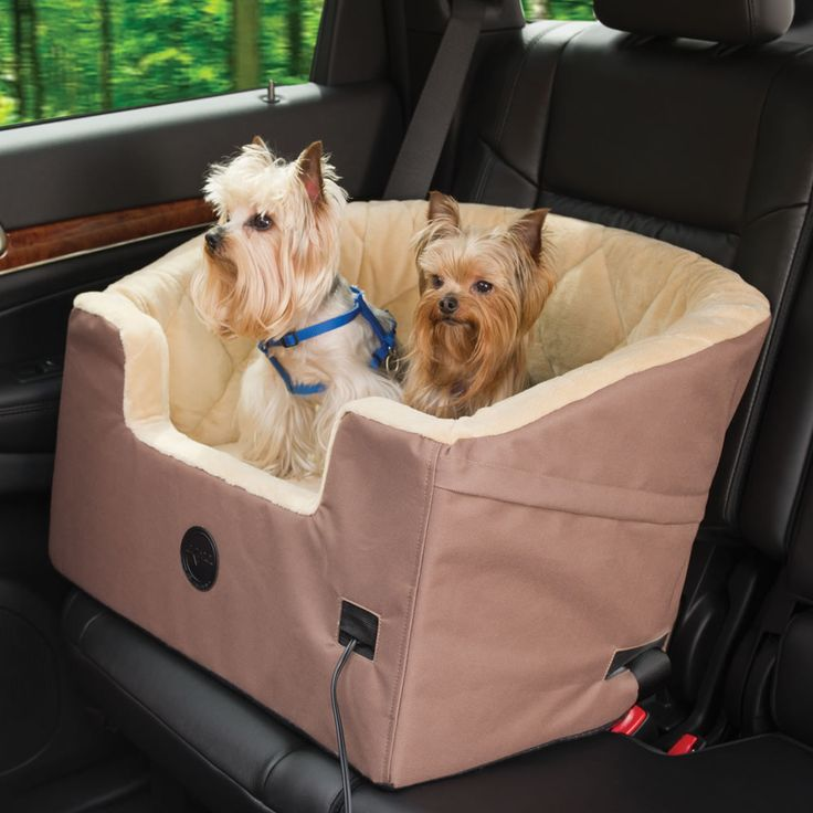 The Heated Pet Car Seat - Hammacher Schlemmer - This is the only pet car seat that is heated to provide cozy, warm quarters for pets during travel.