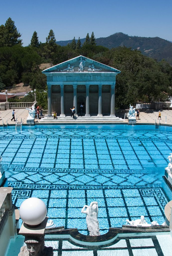 The Neptune Pool at Hearst Castle, Hearst Castle is a National Historic Landmark mansion located on the Central Coast of California, United States. It was designed by architect Julia Morgan between 1919 and 1947 for newspaper magnate William Randolph Hearst. California. Photo by Andy New.