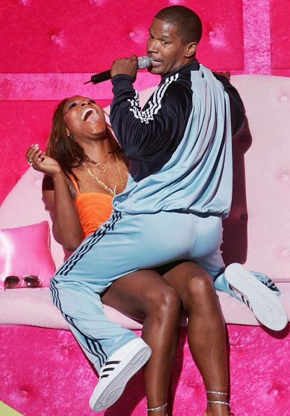 Host Jamie Foxx serenades tennis player Serena Williams with an original song called 'Tennis Ball' on stage at the 12th Annual ESPY Awards held at the Kodak Theatre on July 14, 2004 in Hollywood, California. This year's ESPY's will air Sunday, July 16th on ESPN beginning 9 PM EST/6 PM EST. - The 12th Annual ESPY Awards - Show