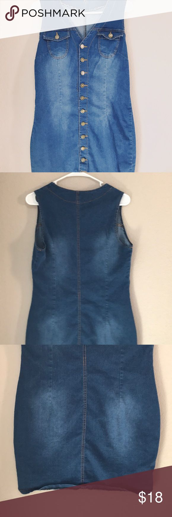 Vintage Denim button down dress Sleeveless button down denim dress All buttons are great  No holes or stains  Not brand or size tag measurements below   Two front pockets   Love this dress😍  Measurements:  Shoulder to bottom of dress: 33 inches  Arm pit to arm pit: 17.5  Width of dress at hips: 18 inches Vintage Dresses Midi