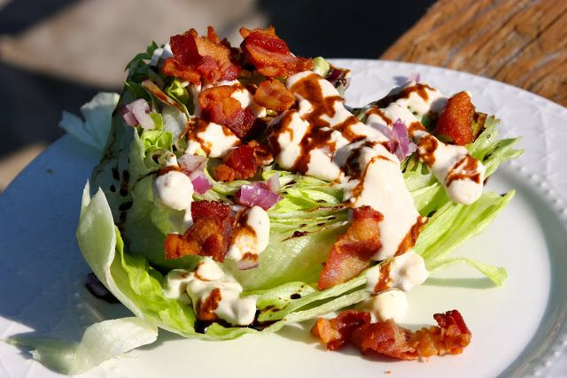Pioneer Woman's Wedge Salad Dressing Recipe - 1 cup mayonnaise, 1/2 cup buttermilk, 1/2 cup sour cream, 1 clove garlic, pressed, 1/2 teaspoon distilled white vinegar, 1/2 teaspoon Worcestershire sauce, 1/4 teaspoon salt, 1/2 teaspoon freshly ground black pepper, 1/8 teaspoon cayenne pepper. Mix together, pour over lettuce wedge and top with shredded cheddar and bacon bits.