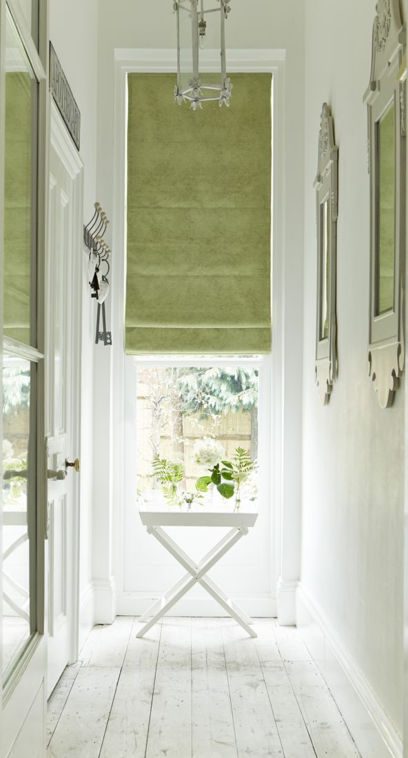 In this light and airy hallway, this fresh and fruity made-to-measure Lyon Apple Roman blind lends a pop of zingy colour to the neutral scheme. Accessorise with plants or coloured mirrors to keep the theme running throughout the room!