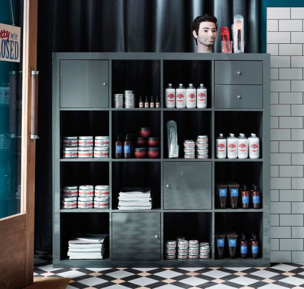Shampoo and styling products displayed in EXPEDIT grey high gloss shelving unit