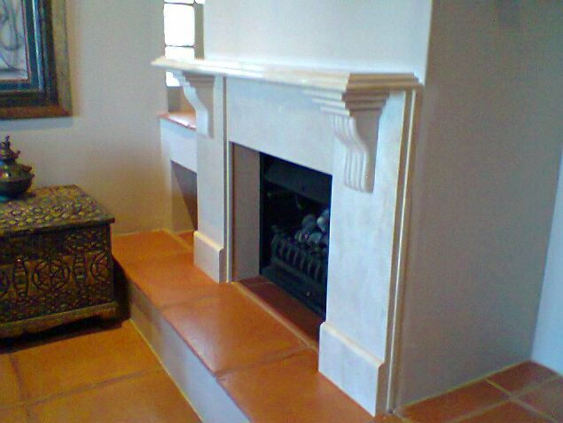 Fancy marble fireplace by Afrigran