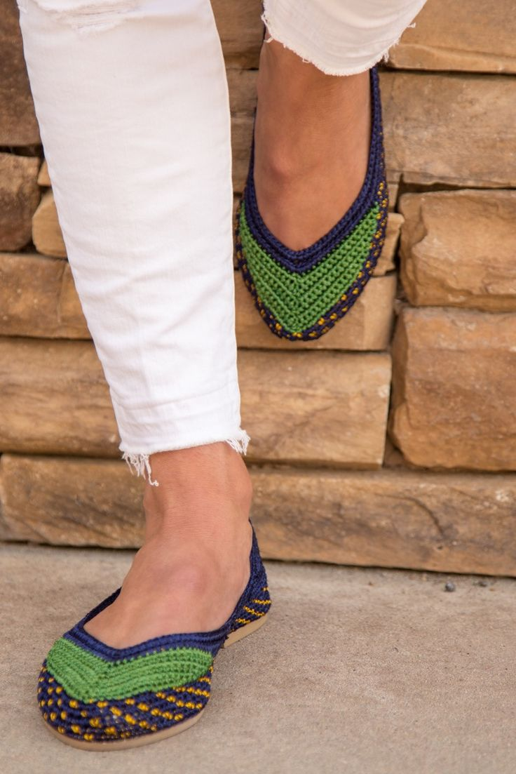 Painted Birds are hand crocheted shoes. Named after Forest Ave. in Laguna Beach, this is a navy blue shoe with bright kelly green detail and gold thread accents. Because each pair is hand made, color