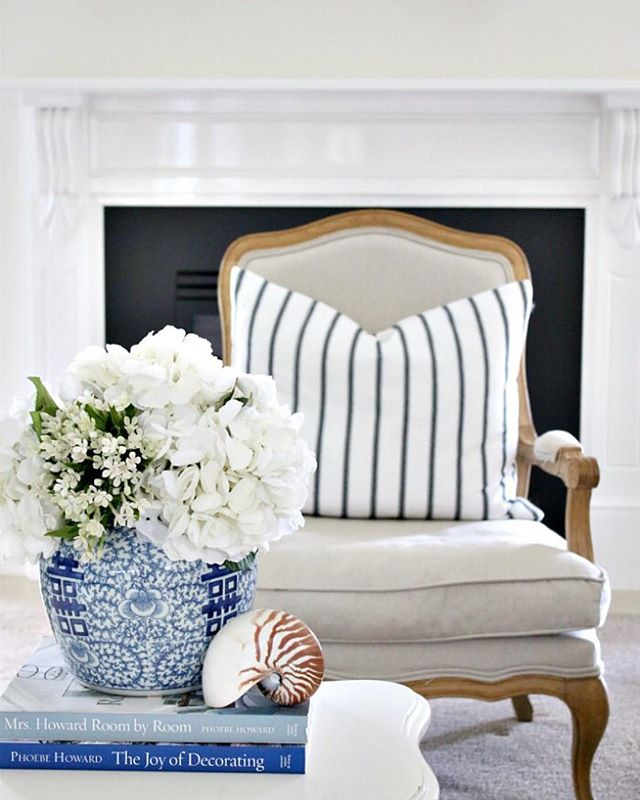Blue and white living room.  White vase of hydrangeas and ginger jar.  Cushion from Provincial Home Living.