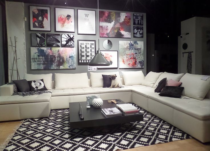 I was feeling inspired by #monochrome #interiors that have a flash colour so decided to create my own version. The #neon pink gallery wall creates a striking backdrop to the stunning white #leather #BoConcept #Mezzo #sofa.