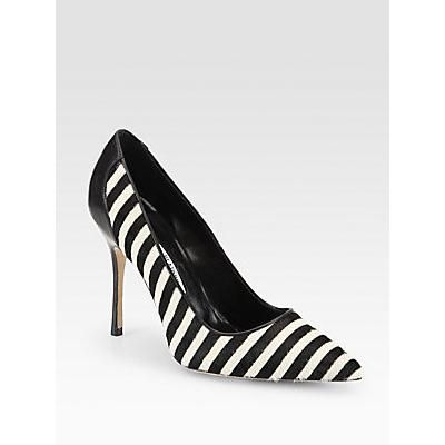 $855, White and Black Horizontal Striped Leather Pumps: Manolo Blahnik Niteroi Striped Pony Hair Leather Pumps Black White. Sold by Saks Fifth Avenue. Click for more info: https://lookastic.com/women/shop_items/134055/redirect