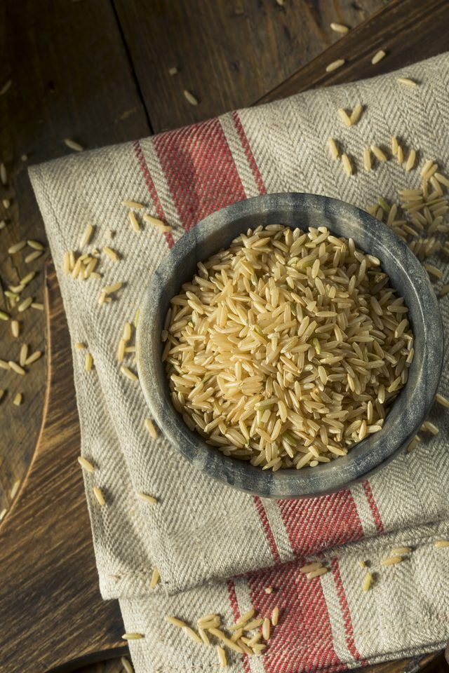 Steps to make fluffy and well separated long grain wild rice in a rice cooker with the proper rice to water ratio.