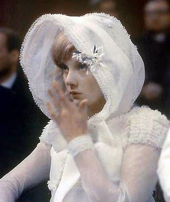 Sylvie Vartan in a beautiful full-length gown and hood pictured during her marriage to Johnny Hallyday on the 12th of April, 1965 in Paris.