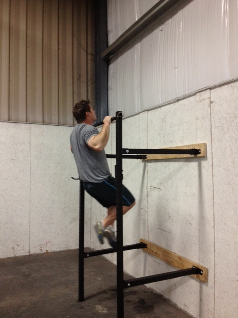 The W-1 wall mounted squat rack with pull up bar conveniently collapses against the wall. Holds several hundred pounds and takes up only inches of space when collapsed. A perfect garage gym addition. http://www.repfitness.com/strength-equipment/squat-racks/w-1-wall-mounted-squat-rack-with-pull-up-bar