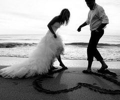 beach wedding photo idea. I love how candid this is, of them drawing he heart…