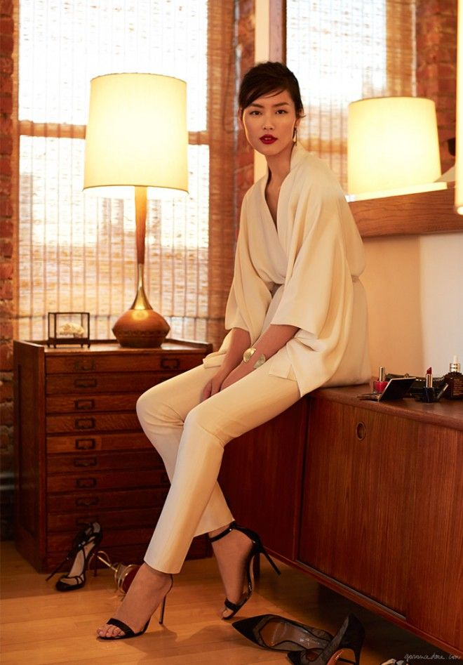 Liu Wen in a showstopping white jumpsuit, complimented by statement makeup and sleek accessories. Photo courtesy of Garance Dore for Estee Lauder.