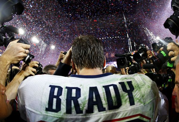 Tom Brady Photos Photos - Tom Brady #12 of the New England Patriots is surrounded by the media after defeating the Seattle Seahawks 28-24 during Super Bowl XLIX at University of Phoenix Stadium on February 1, 2015 in Glendale, Arizona. - Super Bowl XLIX - New England Patriots v Seattle Seahawks