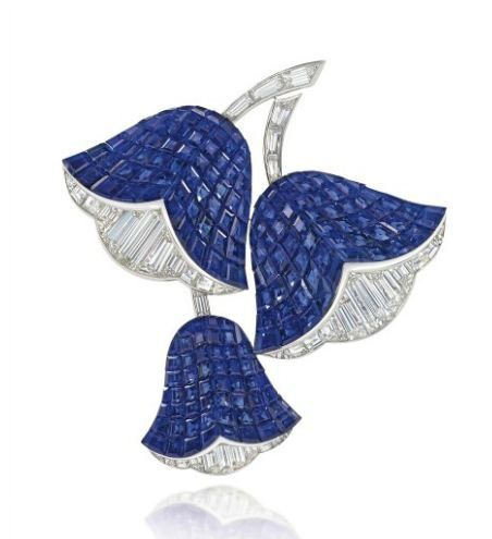 A 'Mystery-Set' Sapphire and Diamond 'Campanule' Brooch, by Van Cleef & Arpels. The three calyxes mounted with mystery-set sapphires and baguette-cut diamonds, to the diamond-set stems, 5.4cm high, with French assay marks for gold, in Van Cleef & Arpels grey suede case  Signed Van Cleef & Arpels, no. M40435