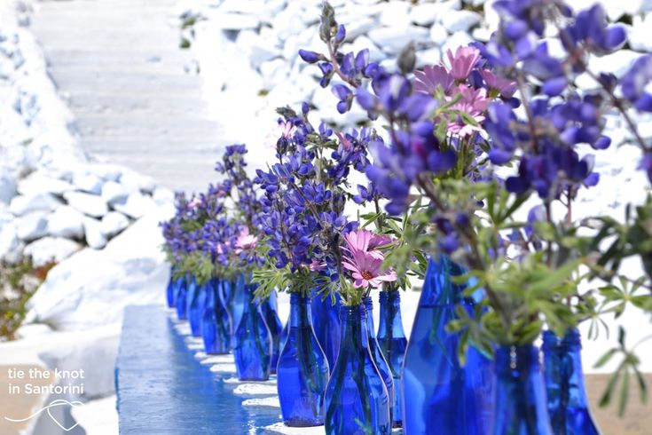 #blueandpurple DIY Santorini Wedding |See the full post here:http://tietheknotsantorini.com/blog/diy-santorini-wedding-decor-blue-purple