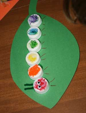 Bottle cap caterpillar--how fun and a great way to teach your kids to recycle. Plus they might want to read the Hungry Caterpillar book..classic.