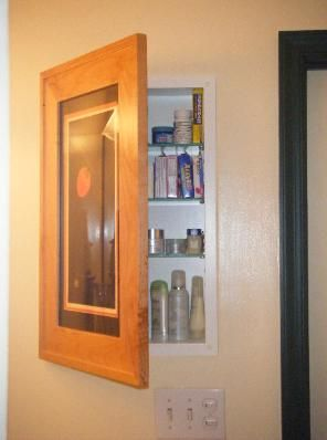 The Concealed Cabinet - a recessed, mirrorless medicine cabinet hidden behind a picture frame door