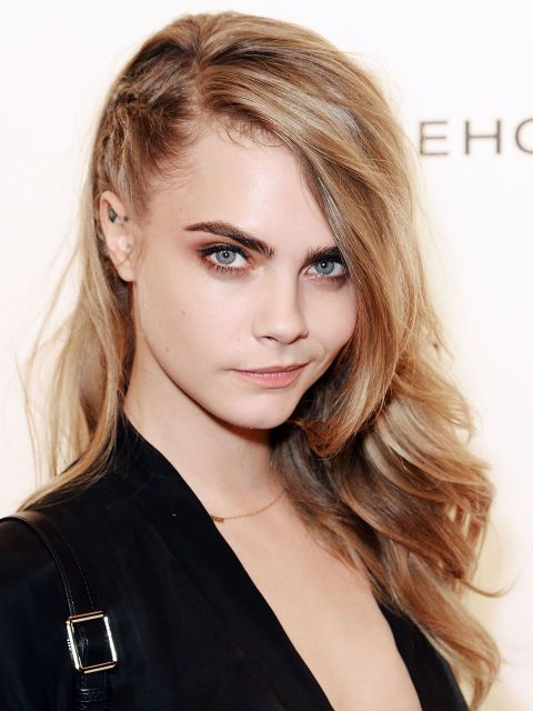 You don't have to shave your head to get an edgy undercut! To fake the look, take a cue from Cara Delevingne, and create a tight cornrow braid on one side instead.