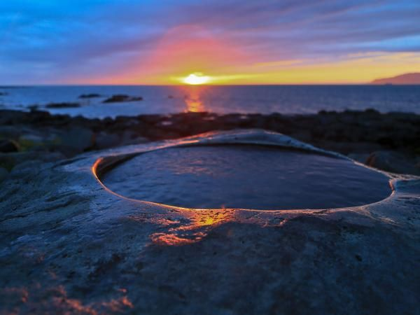 Midnight Sun and perfect warm water to  dip your toes in| Visit Reykjavík