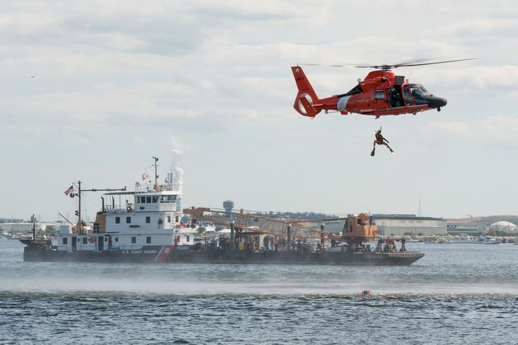 A Coast Guard rescue swimmer is hoisted from an MH-60 Dolphin helicopter from Air Station Atlantic City, N.J., during a search and rescue demonstration off the banks of Baltimore's Fort McHenry during the Star-Spangled Spectacular air show, Sunday, Sept. 14, 2014. The demonstration was to prepare for two shows as part of the city's multi-day Star-Spangled Spectacular events commemorating the 200th anniversary of the penning of the national anthem. (U.S. Coast Guard photograph by Petty…